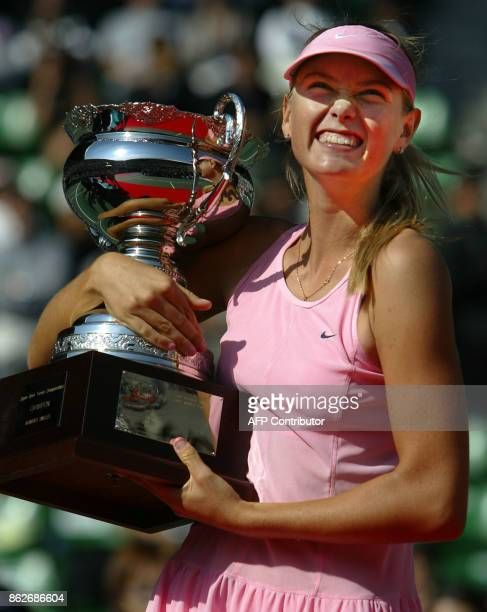 Maria Sharapova of Russia smiles as she holds the trophy during award ceremony for women's singles after the final match against Aniko Kapros of...