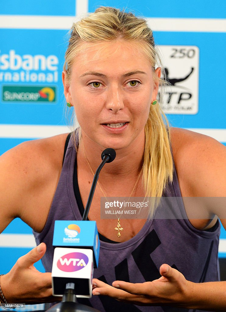 Maria Sharapova of Russia speaks at a press conference where she announced she was withdrawing from the Brisbane International tennis tournament with a collar bone injury on January 1, 2013. AFP PHOTO/William WEST USE