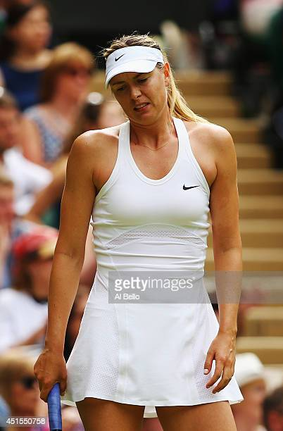 Maria Sharapova of Russia stands dejected during her Ladies' Singles fourth round match against Angelique Kerber of Germany on day eight of the...