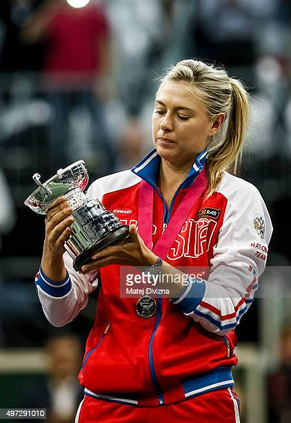 Maria Sharapova of Russia stands on the podium with Russia's second place trophy after the Fed Cup final match between Czech Republic and Russia at...