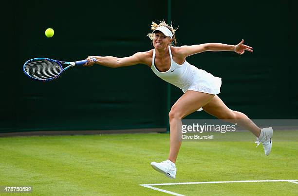 Maria Sharapova of Russia stretches to play a forehand during a practice session prior to the Wimbledon Lawn Tennis Championships at the All England...