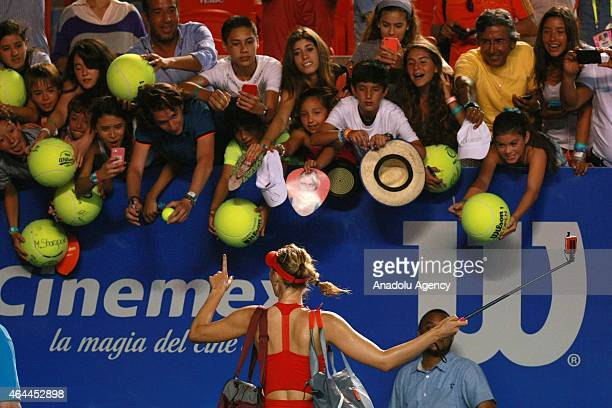 Maria Sharapova of Russia takes selfie with her fans after a women single match against Mariana DuqueMarino of Colombia within Telcel Mexican Open...