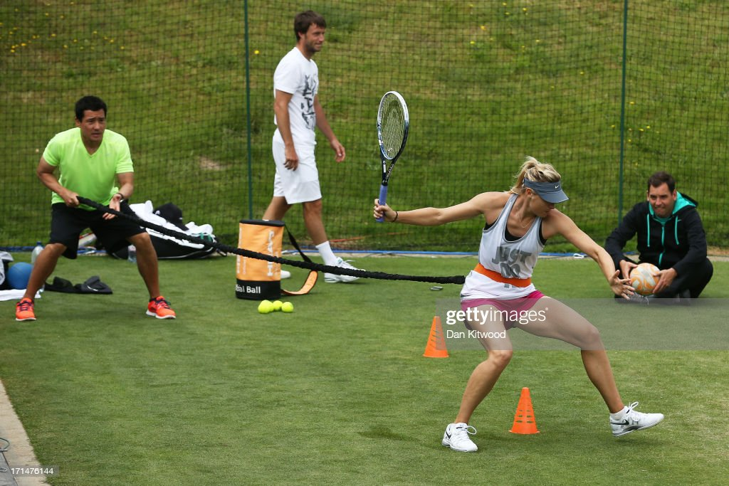 Maria Sharapova of Russia trains during a practice session with members of her coaching team on day two of the Wimbledon Lawn Tennis Championships at the All England Lawn Tennis and Croquet Club on June 25, 2013 in London, England.