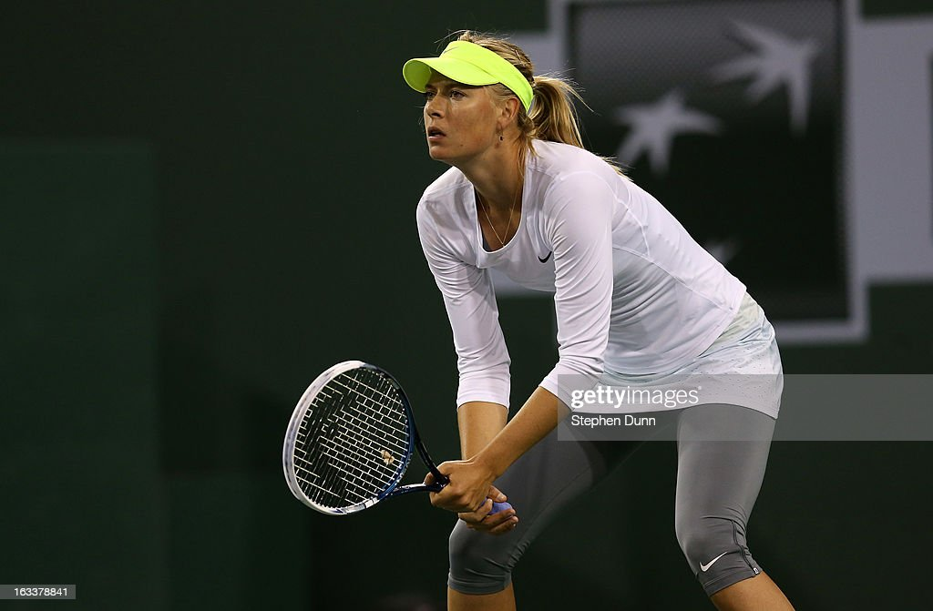 Maria Sharapova of Russia waits for a serve from Francesca Schiavone of Italy during day 3 of the BNP Paribas Open at Indian Wells Tennis Garden on March 8, 2013 in Indian Wells, California.