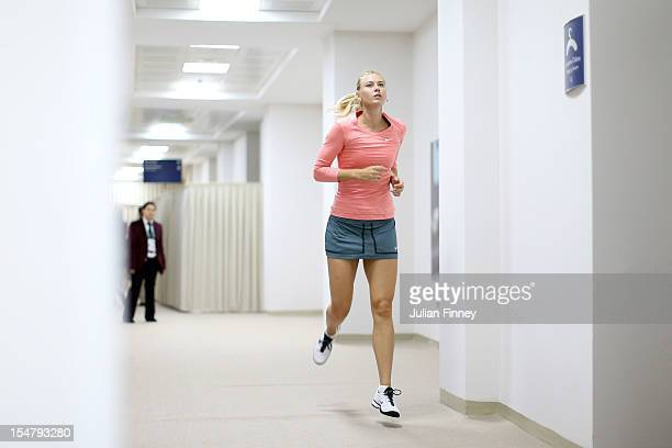 Maria Sharapova of Russia warms up backstage as she prepares for her match against Samantha Stosur of Australia during day four of the season ending...