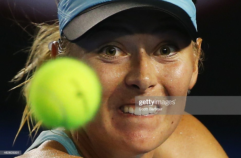 <a gi-track='captionPersonalityLinkClicked' href=/galleries/search?phrase=Maria+Sharapova&family=editorial&specificpeople=157600 ng-click='$event.stopPropagation()'>Maria Sharapova</a> of Russia watches the ball during her first round match against Bethanie Mattek-Sands of the United States during day two of the 2014 Australian Open at Melbourne Park on January 14, 2014 in Melbourne, Australia.