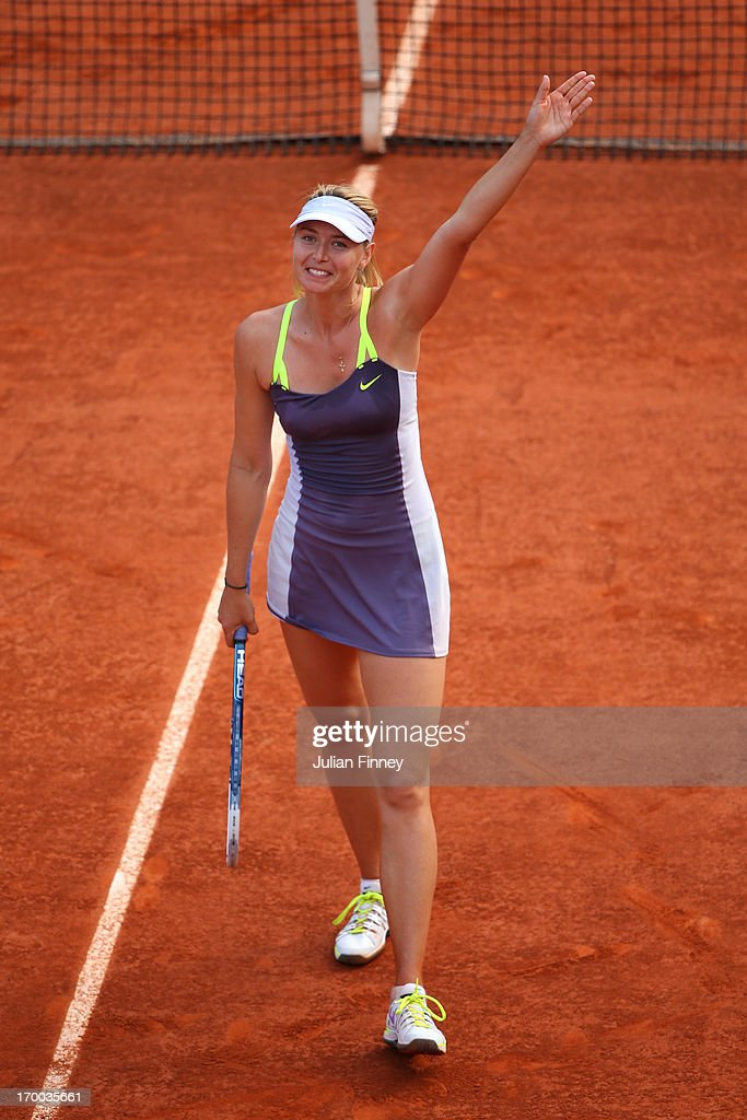 <a gi-track='captionPersonalityLinkClicked' href=/galleries/search?phrase=Maria+Sharapova&family=editorial&specificpeople=157600 ng-click='$event.stopPropagation()'>Maria Sharapova</a> of Russia waves to the crowd after vicotry in her womens' singles semi-final match against Victoria Azarenka of Belarus against during day twelve of the French Open at Roland Garros on June 6, 2013 in Paris, France.