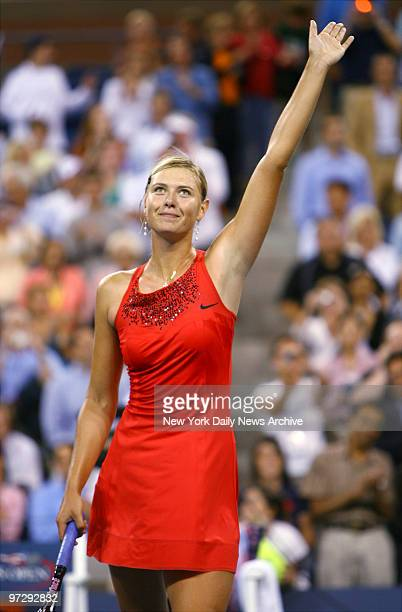 Maria Sharapova of Russia waves to the crowd as she celebrates her 60 61 straightset victory over Roberta Vinci of Italy during their 2007 US Open...