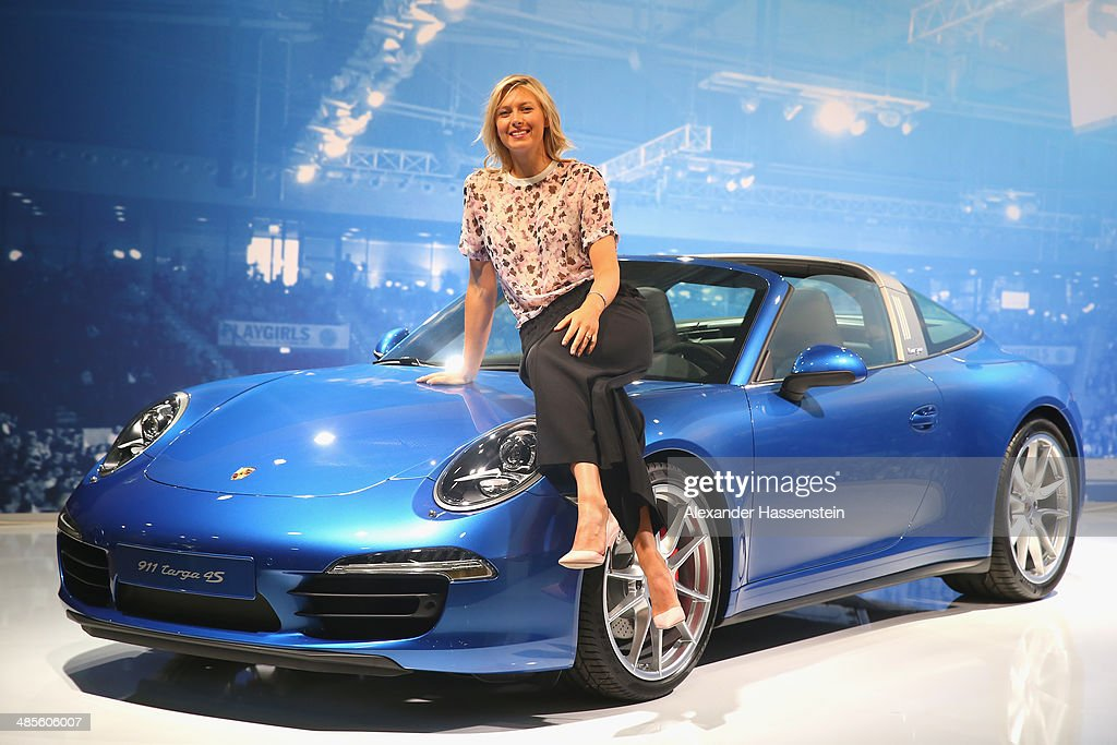 Maria Sharapova Porsche's global brand ambassador poses with the Porsche Tennis Grand Prix 2014 winners car the Porsche targa 4s at the Porsche Arena...