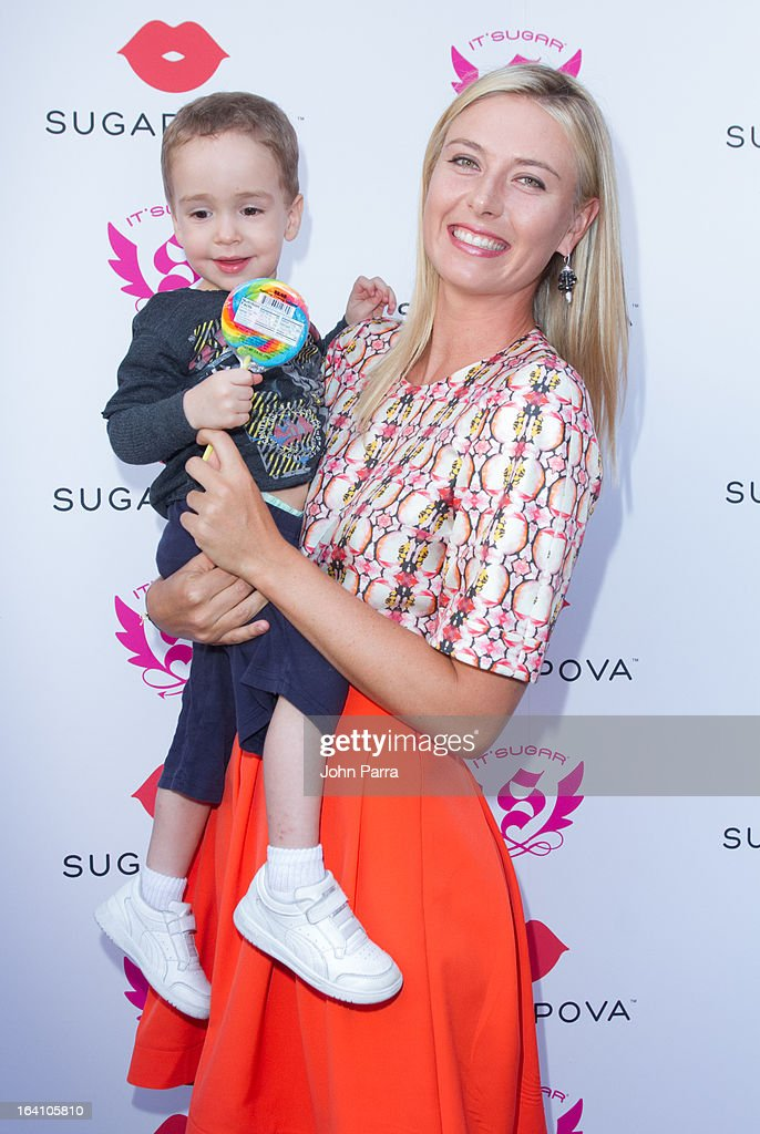 <a gi-track='captionPersonalityLinkClicked' href=/galleries/search?phrase=Maria+Sharapova&family=editorial&specificpeople=157600 ng-click='$event.stopPropagation()'>Maria Sharapova</a> (R) poses with her youngest fan during the launch of her candy collection Sugarpova in Miami at IT'SUGAR at Sunset Place on March 19, 2013 in Miami, Florida.