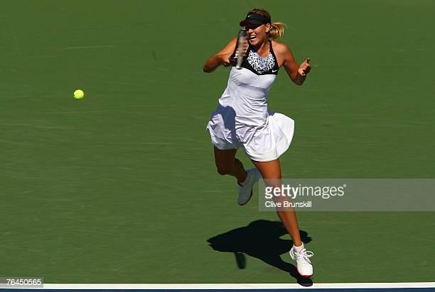 Maria Sharapova returns a shot against Agnieszka Radwanska of Poland during day six of the 2007 US Open at the Billie Jean King National Tennis...