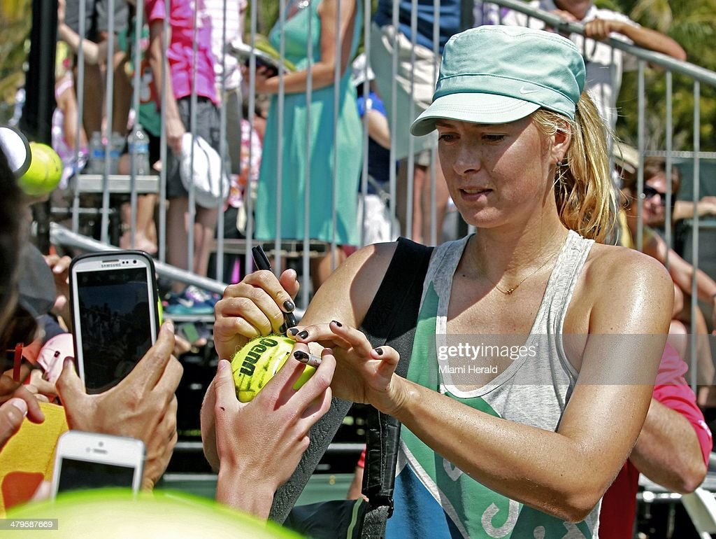 Maria Sharapova signs autographs for fans after her practice at the Sony Open tennis tournament at Crandon Park in Key Biscayne, Fla., on Wednesday, March 19, 2014.