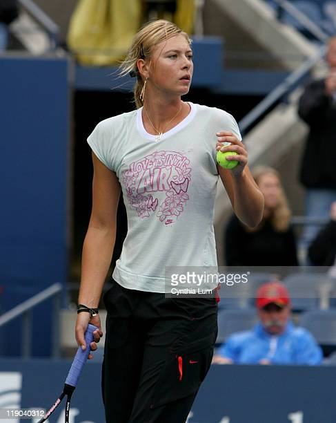 Maria Sharapova warms up in Arthur Ashe Stadium during brief dry spell at the US Open played at the USTA Billie Jean King Tennis Center Flushing...