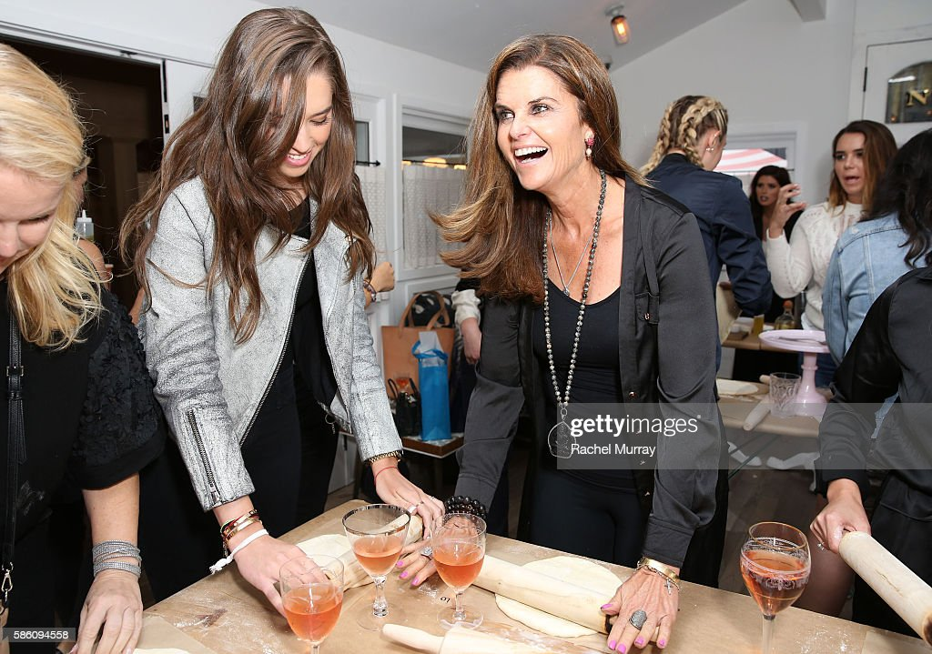 Maria Shriver and daughter Christina Schwarzenegger make pizza during Katherine Schwarzenegger's Amazon Echo cooking class at AU FUDGE on August 4...