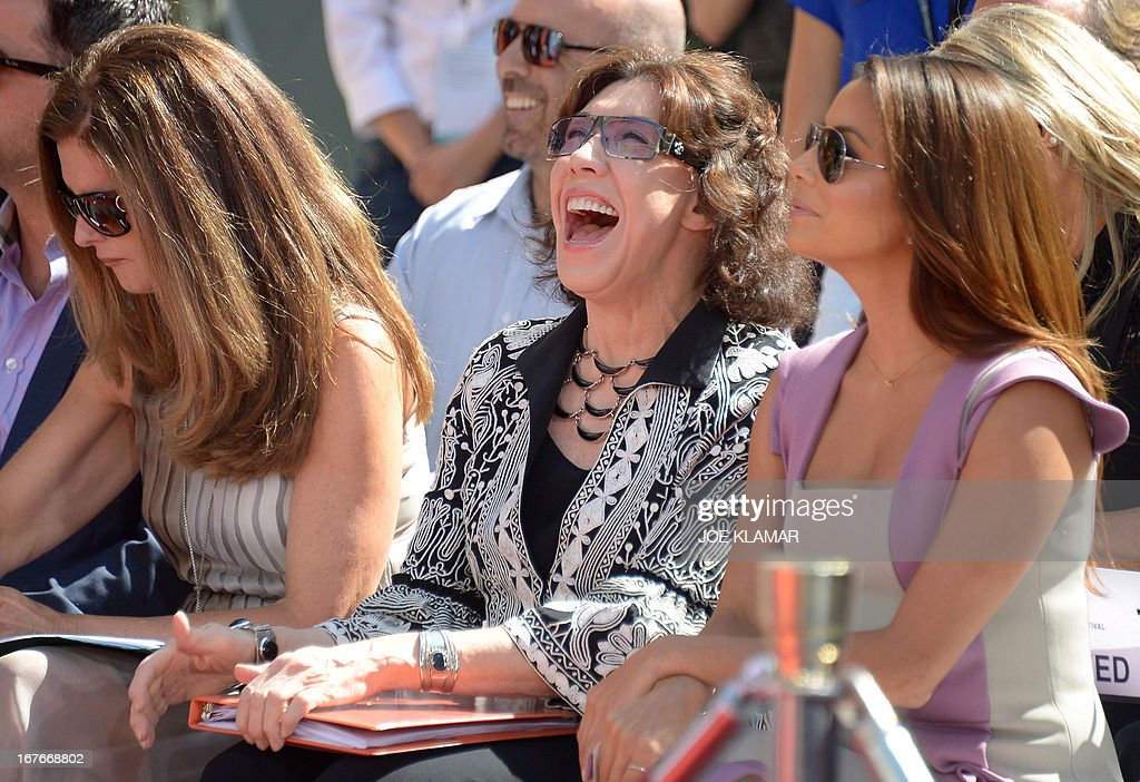 L-R Maria Shriver , Lily Tomlin and Eva Longoria attend Jane Fonda's Handprint/Footprint Ceremony during the 2013 TCM Classic Film Festival at TCL Chinese Theatre on April 27, 2013 in Los Angeles. Fonda is an American actress, writer, political activist, former fashion model, and fitness guru. She rose to fame in the 1960s with films such as Barbarella and Cat Ballou. She has won two Academy Awards, an Emmy Award, three Golden Globes and received several other movie awards and nominations during more than 50 years as an actress. After 15 years of retirement, she returned to film in 2005 with Monster-in-Law, followed by Georgia Rule two years later. She also produced and starred in over 20 exercise videos released between 1982 and 1995, and once again in 2010. AFP PHOTO/JOE KLAMAR