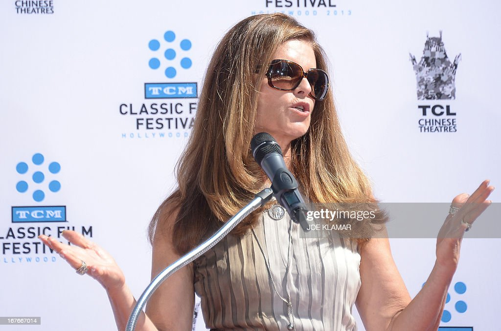 Maria Shriver speaks during Jane Fonda's Handprint/Footprint Ceremony during the 2013 TCM Classic Film Festival at TCL Chinese Theatre on April 27, 2013 in Los Angeles. Fonda is an American actress, writer, political activist, former fashion model, and fitness guru. She rose to fame in the 1960s with films such as Barbarella and Cat Ballou. She has won two Academy Awards, an Emmy Award, three Golden Globes and received several other movie awards and nominations during more than 50 years as an actress. After 15 years of retirement, she returned to film in 2005 with Monster-in-Law, followed by Georgia Rule two years later. She also produced and starred in over 20 exercise videos released between 1982 and 1995, and once again in 2010. AFP PHOTO/JOE KLAMAR