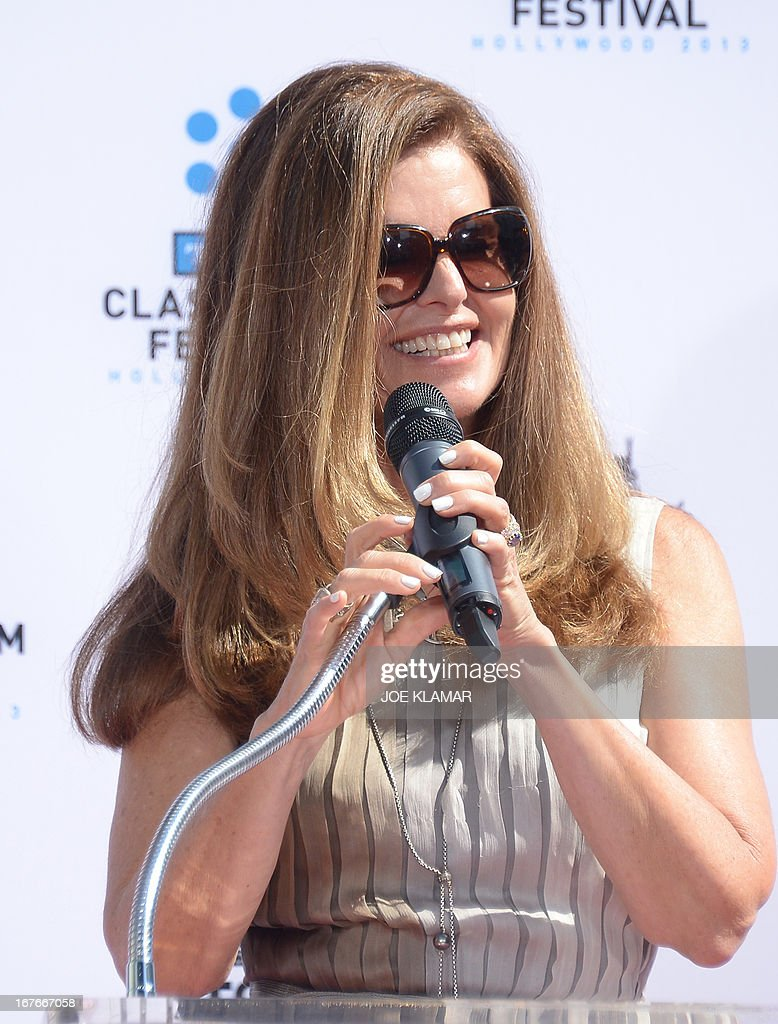 Maria Shriver speaks during Jane Fonda's Handprint/Footprint Ceremony during the 2013 TCM Classic Film Festival at TCL Chinese Theatre on April 27, 2013 in Los Angeles. Fonda is an American actress, writer, political activist, former fashion model, and fitness guru. She rose to fame in the 1960s with films such as Barbarella and Cat Ballou. She has won two Academy Awards, an Emmy Award, three Golden Globes and received several other movie awards and nominations during more than 50 years as an actress. After 15 years of retirement, she returned to film in 2005 with Monster-in-Law, followed by Georgia Rule two years later. She also produced and starred in over 20 exercise videos released between 1982 and 1995, and once again in 2010.