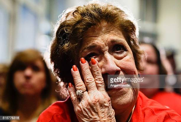 Maria Silva wipes a tear as she listens to Republican presidential candidate US Senator Marco Rubio at a primary night event on March 15 2016 in...