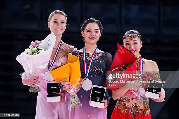 Maria Sotskova of Russia Evgenia Medvedeva of Russia Wakaba Higuchi of Japan pose during the Ladies Singles medal ceremony on day two of the Trophee...