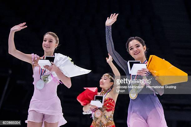 Maria Sotskova of Russia Wakaba Higuchi of Japan Evgenia Medvedeva of Russia celebrate after the Ladies Singles medal ceremony on day two of the...