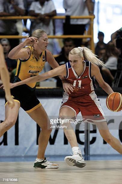 Maria Stepanova of Russia drives against Lauren Jackson of Australia during the gold medal game during the gold medal game between Australia and...