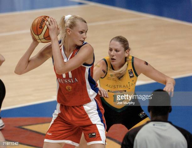 Maria Stepanova of Russia is defended by Lauren Jackson of Australia during the gold medal game between Australia and Russia during the 2006 FIBA...