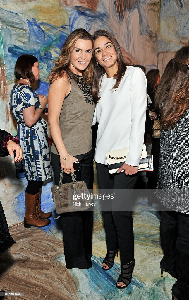 Maria Sukkar (R) and guest attend the book launch of Art Studio America at ICA on November 11, 2013 in London, England.