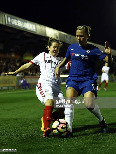 Maria Thorisdottir of Chlesea Ladies is tackled by Leonie Maier of Bayern Munich during the UEFA Womens Champions League Round of 32 First Leg match...