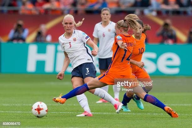 Maria Thorisdottir of Norway and Jackie Groenen of the Netherlands battle for the ball during their Group A match between Netherlands and Norway...