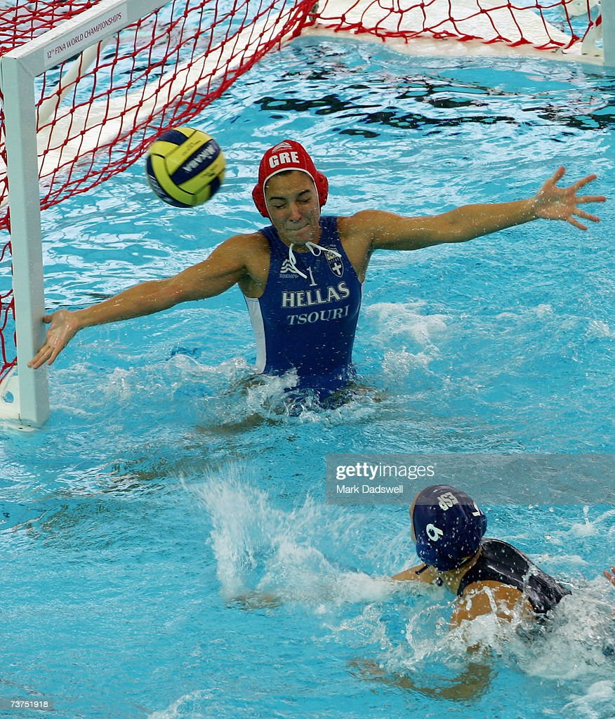 Maria Tsouri of Greece attempts to save a shot from Jennifer Pareja Lisalde of Spain during the Women's 7th8th Place Water Polo match between Greece...