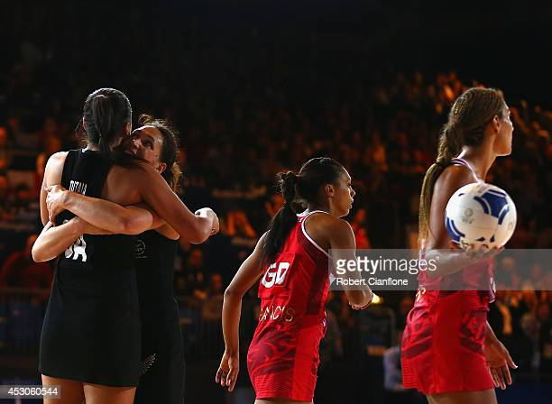 Maria Tutaia and Jodi Brown of New Zealand celebrate after New Zealand defeated England in the netball semi final between New Zealand and England at...