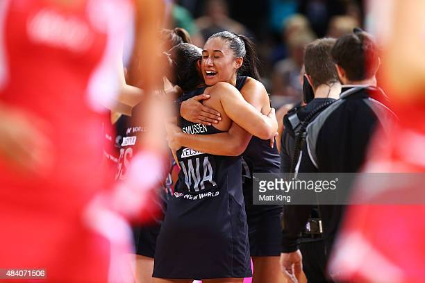 Maria Tutaia of New Zealand celebrates with Grace Rasmussen of New Zealand after their win in the 2015 Netball World Cup Semi Final 1 match between...