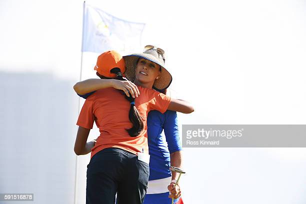 Maria Verchenova of Russia and Aditi Ashok of India embrace on the 18th green during the First Round of Women's Golf at Olympic Golf Course on Day 12...