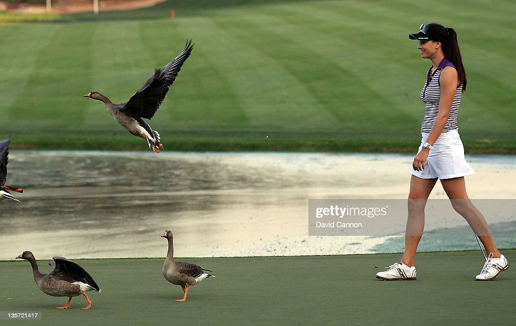 <a gi-track='captionPersonalityLinkClicked' href=/galleries/search?phrase=Maria+Verchenova&family=editorial&specificpeople=2646610 ng-click='$event.stopPropagation()'>Maria Verchenova</a> of Russia upsets the geese as she walks onto the 18th green during the pro-am competition for the 2011 Omega Dubai Ladies Masters on the Majilis Course at the Emirates Golf Club on December 13, 2011 in Dubai, United Arab Emirates.