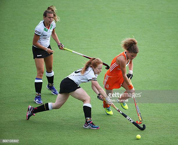 Maria Verschoor of the Netherlands is tackled by Nina Hasselmann of Germany during the Hockey World League Final Pool A match between the Netherlands...
