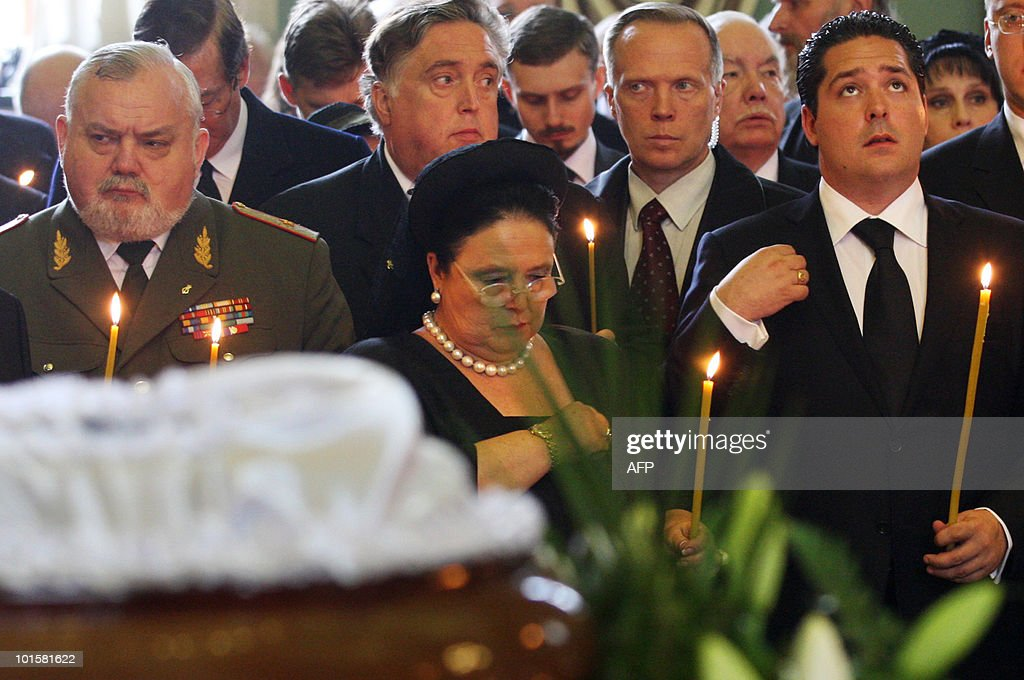 Maria Vladimirova (C), daughter of late Grand Duchess Leonida Georgievna of the Romanov dynasty makes a sign of the cross in St. Petersburg on June 3, 2010 during her funeral at the Peter and Paul Cathedral. Grand Duchess Leonida Georgievna, a senior member of Russia's Romanov dynasty, died on May 23, 2010 aged 95 after a life that saw her marry a US industrialist and then the claimant to the Russian throne. Born in 1914 before the Russian Revolution that ousted the Romanov imperial family, she had been the last surviving member of the dynasty to be born in the Russian Empire, a spokesman for the family said. At right is Leonida's grandson Georgy.