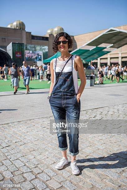 Maria wears Guess dungaree Zara Tshirt Converse sneakers and Rayban sunglasses during day 1 of Sonar Music Festival on June 18 2015 in Barcelona Spain