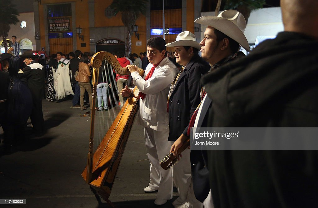 A mariachi band awaits clients at Garibaldi Plaza late on June 29, 2012 in Mexico City, Mexico. Revelers partied into the early hours of the morning, even as a midnight ban on the sale of alcohol went into effect. The alcohol ban, known as 'ley seca' is meant to curb possible violence as Mexicans go to the polls Sunday to choose a new president.