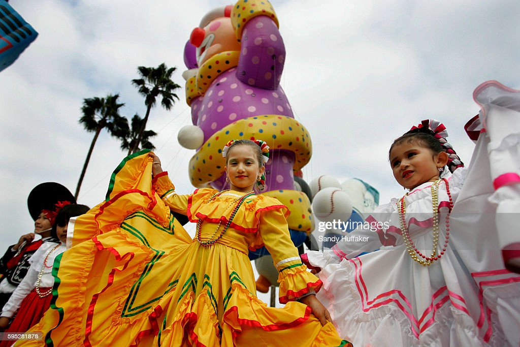 Mariachi Dancers wait in line in front of Giant Balloon floats before marching down Harbor Blvd during the Pacific Life Holiday Bowl Parade in San...