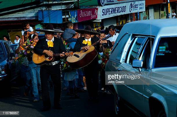 Mariachi Guitars Accompany A Funeral Procession