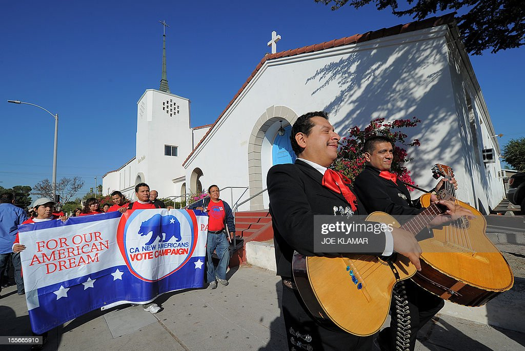 Mariachi musicians sing and play as they go from house to house to encourage people to come to vote on election day at the Sun Valley's Latino district, Los Angeles County, on November 6, 2012 in California.