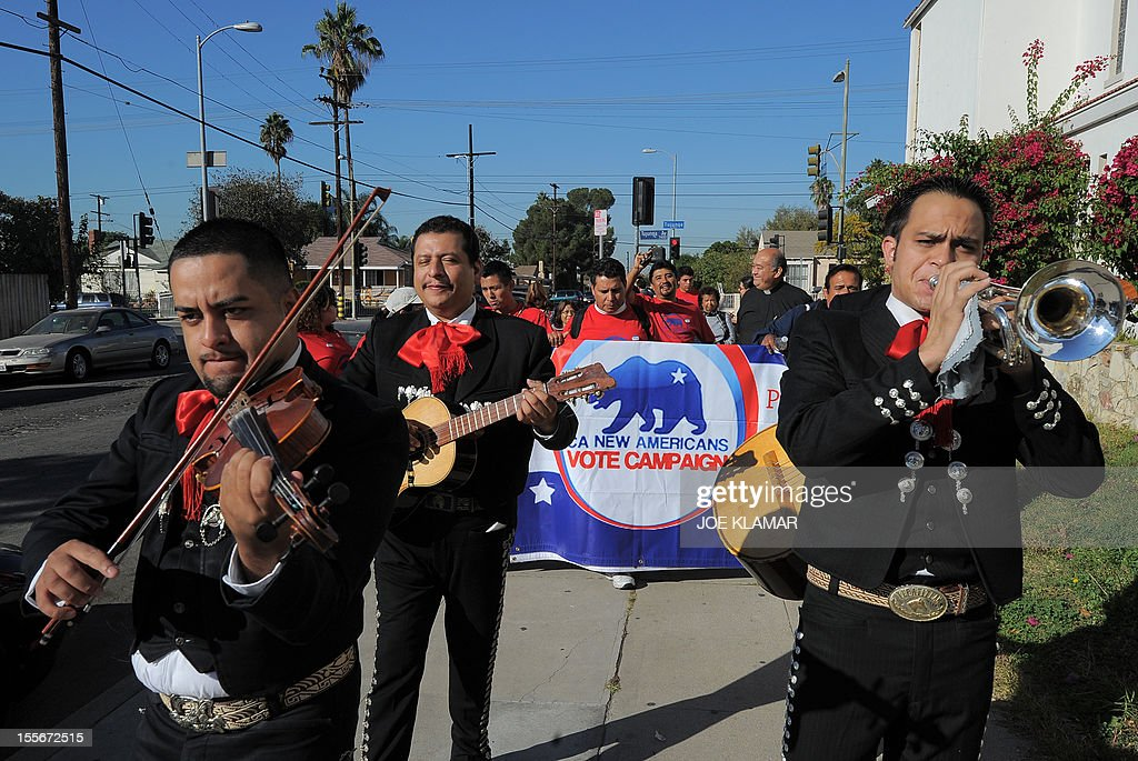 Mariachi musicians sing and play serenadas as they go from house to house to encourage people to come to vote on election day in the predominantly Latino Sun Valley district of Los Angeles on November 6, 2012. From Mexican Americans and Puerto Ricans to Cuban Americans, the more than 12 million Hispanic Americans eligible to vote could hold the keys to the White House.