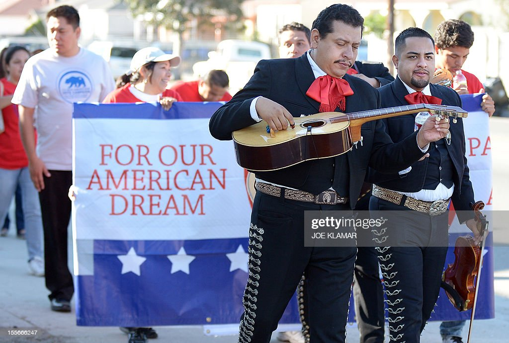 Mariachi musicians sing and play serenadEs as they go from house to house to encourage people to come to vote on election day in the predominantly Latino Sun Valley district of Los Angeles on November 6, 2012. From Mexican Americans and Puerto Ricans to Cuban Americans, the more than 12 million Hispanic Americans eligible to vote could hold the keys to the White House.
