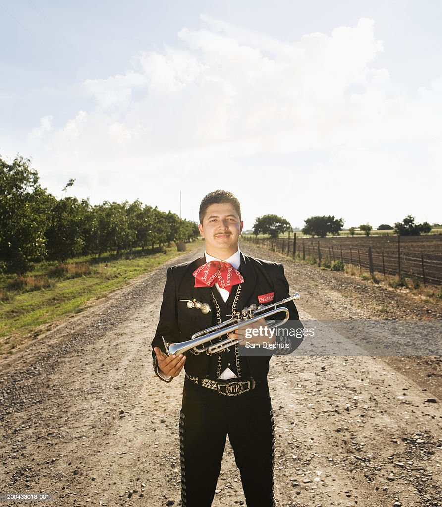 Mariachi player holding trumpet
