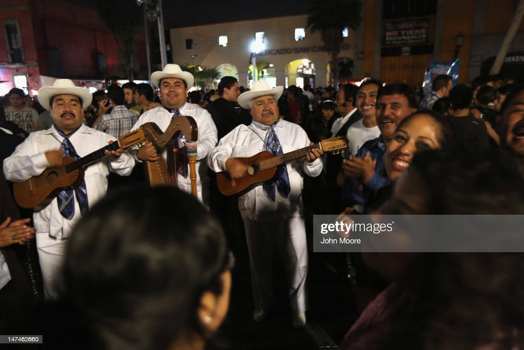 Mariachis play to a joyous crowd at Garibaldi Plaza early on June 30, 2012 in Mexico City, Mexico. Revelers partied into the early hours of the morning, even as a midnight ban on the sale of alcohol went into effect. The alcohol ban, known as 'ley seca' is meant to curb possible violence as Mexicans go to the polls Sunday to choose a new president.