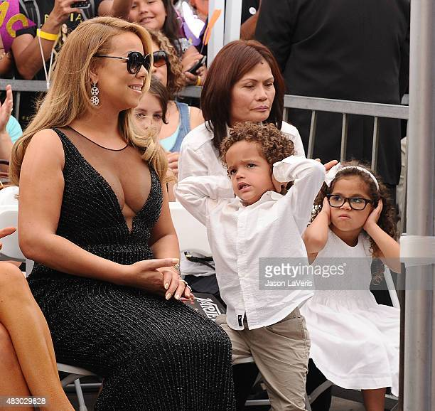 Mariah Carey and children Moroccan Scott Cannon and Monroe Cannon attend Carey's induction into the Hollywood Walk of Fame on August 5 2015 in...