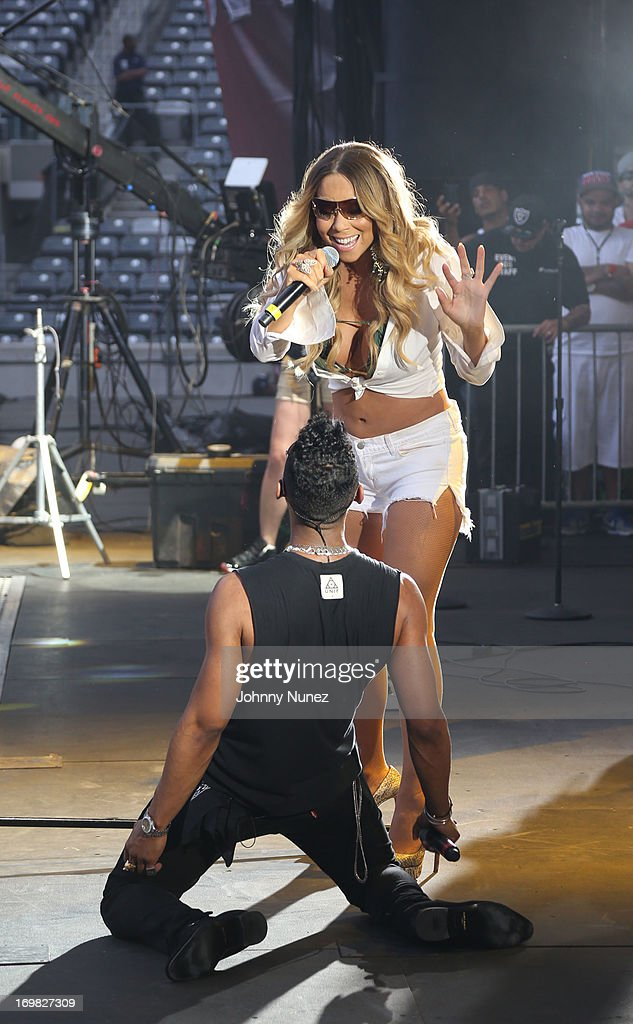 <a gi-track='captionPersonalityLinkClicked' href=/galleries/search?phrase=Mariah+Carey&family=editorial&specificpeople=171647 ng-click='$event.stopPropagation()'>Mariah Carey</a> and Miguel perform during HOT 97 Summer Jam XX at MetLife Stadium on June 2, 2013 in East Rutherford, New Jersey.