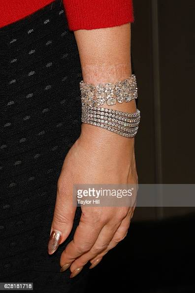 Mariah Carey bracelet detail ring detail manicure detail visits the Empire State Building on December 6 2016 in New York City