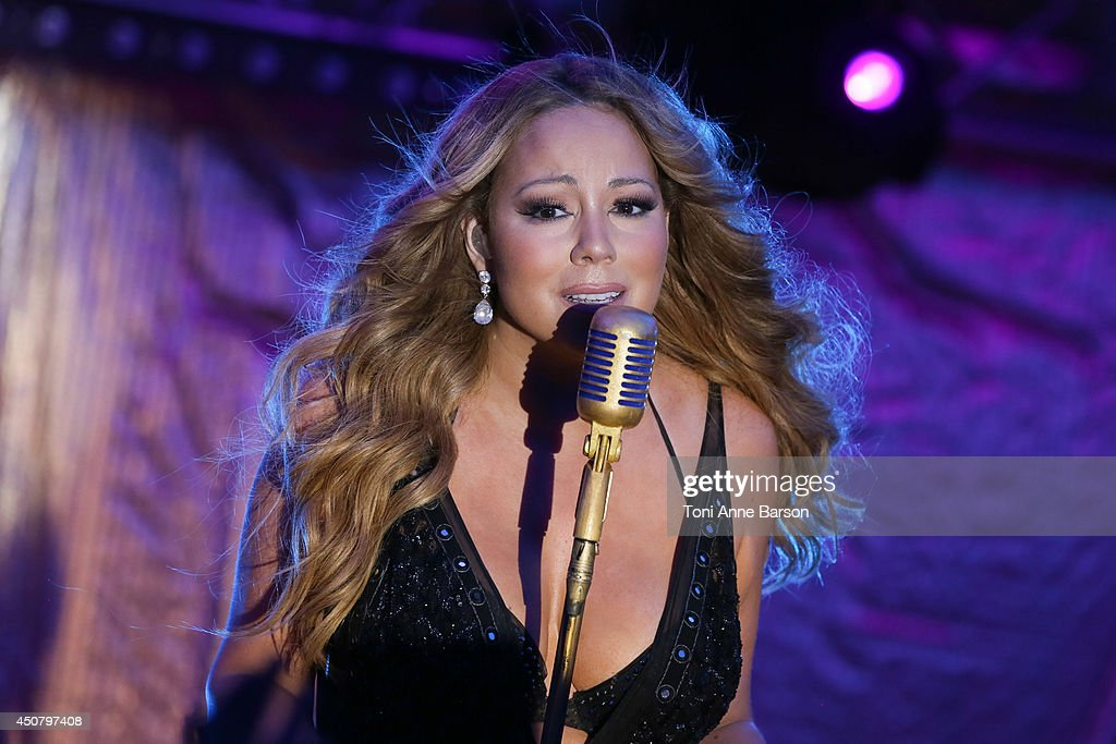 <a gi-track='captionPersonalityLinkClicked' href=/galleries/search?phrase=Mariah+Carey&family=editorial&specificpeople=171647 ng-click='$event.stopPropagation()'>Mariah Carey</a> performs during Clear Channel Media And Entertainment And MediaLink Dinner at Hotel du Cap-Eden-Roc on June 17, 2014 in Cap d'Antibes, France.