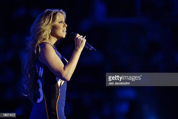 Mariah Carey performs for Michael Jordan during halftime at the 2003 NBA AllStar Game on February 9 2003 at Philips Arena in Atlanta Georgia The West...